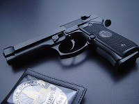 police_badge_and_gun_t2_1_
