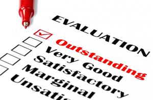 outstanding_evaluation_marked_with_red_pen